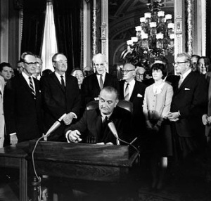 LBJ signs Voting Rights Act